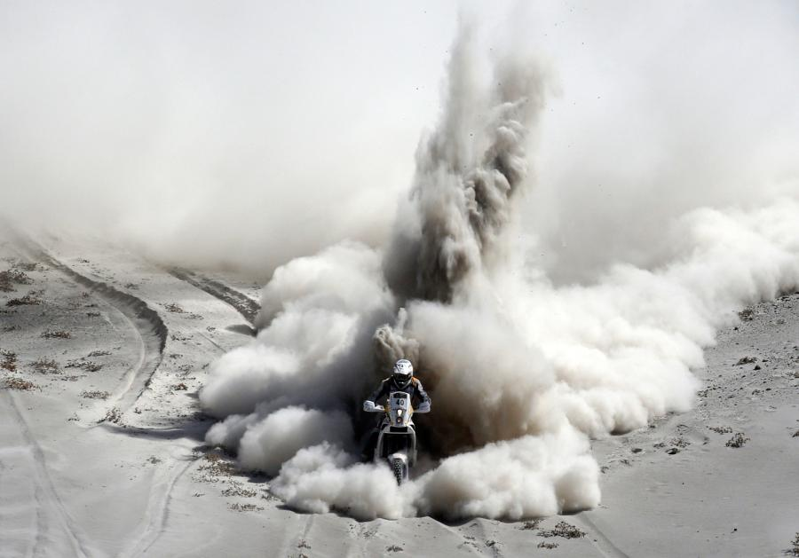 Image: South Africa's Van Niekerk rides his KTM during the 5th stage of the Dakar Rally 2013 from Arequipa in Peru to Arica in Chile